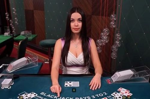 Anastacia is a live dealer at blackjack.